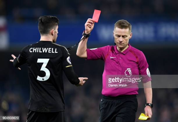 Ben Chilwell of Leicester City is shown a red card by referee Mike Jones during the Premier League match between Chelsea and Leicester City at...