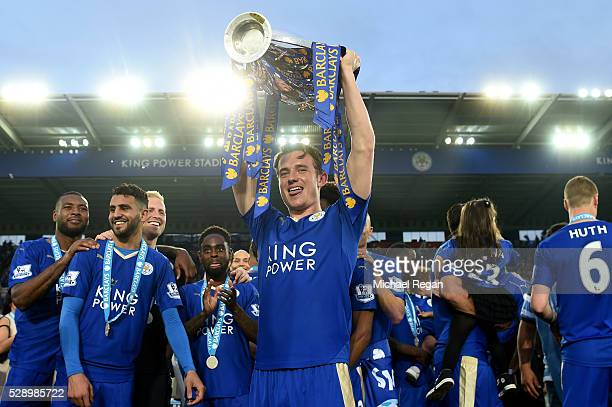 Ben Chilwell of Leicester City lifts the Premier League Trophy as players and staffs celebrate the season champions after the Barclays Premier League...