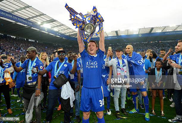 Ben Chilwell of Leicester City lifts the Premier League Trophy as players and staffs celebrate the season champion after the Barclays Premier League...