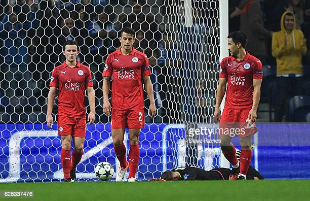 Ben Chilwell of Leicester City Luis Hernandez of Leicester City and Shinji Okazaki of Leicester City are dejected after FC Porto score their third...