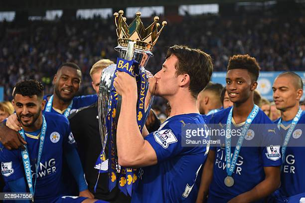Ben Chilwell of Leicester City poses with the Premier League Trophy as players and staffs celebrate the season champions after the Barclays Premier...