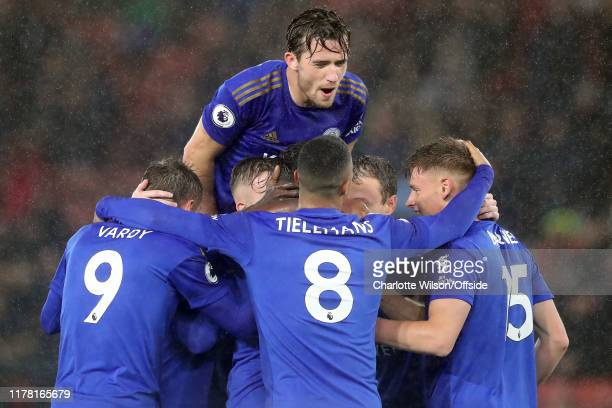 Ben Chilwell of Leicester jumps on his teammates as he celebrates their 6th goal during the Premier League match between Southampton FC and Leicester...