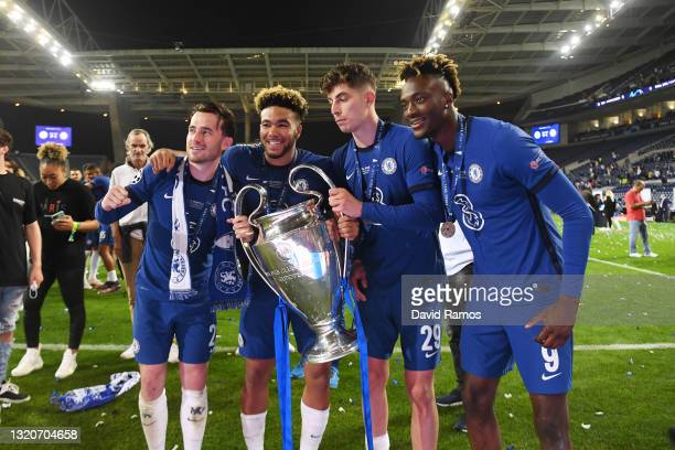 Ben Chilwell, Reece James, Kai Havertz and Tammy Abraham of Chelsea pose with the Champions League Trophy following their team's victory in the UEFA...
