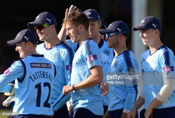 Ben Coad of Essex Eagles celebrates with teammates after the dismissal of Tom Westley during the Royal London OneDay Cup match between Essex Eagles...