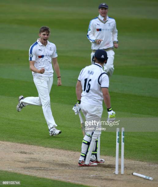 Ben Coad of Yorkshire celebrates dismissing Sam Hain of Warwickshire during day three of the Specsavers County Championship Division One match...