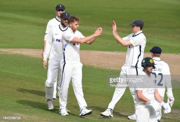 Ben Coad of Yorkshire celebrates taking the wicket of Steven Mullaney of Nottinghamshire during the LV= Insurance County Championship match between...