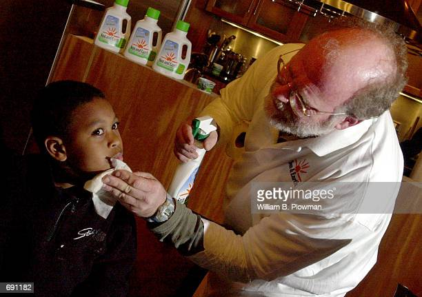 Ben Cohen of Ben Jerrys ice cream fame wipes ice cream off Okera Harris seven after sponsoring a local fiveyearolds birthday ice cream party January...