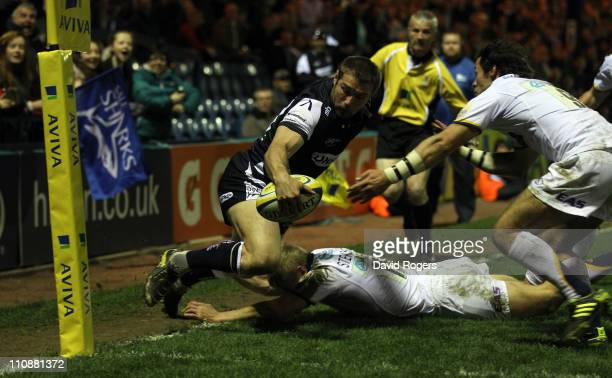 Ben Cohen of Sale is knocked into touch by Michael Stephenson and Scott Mathie during the Aviva Premiership match between Sale Sharks and Leeds...