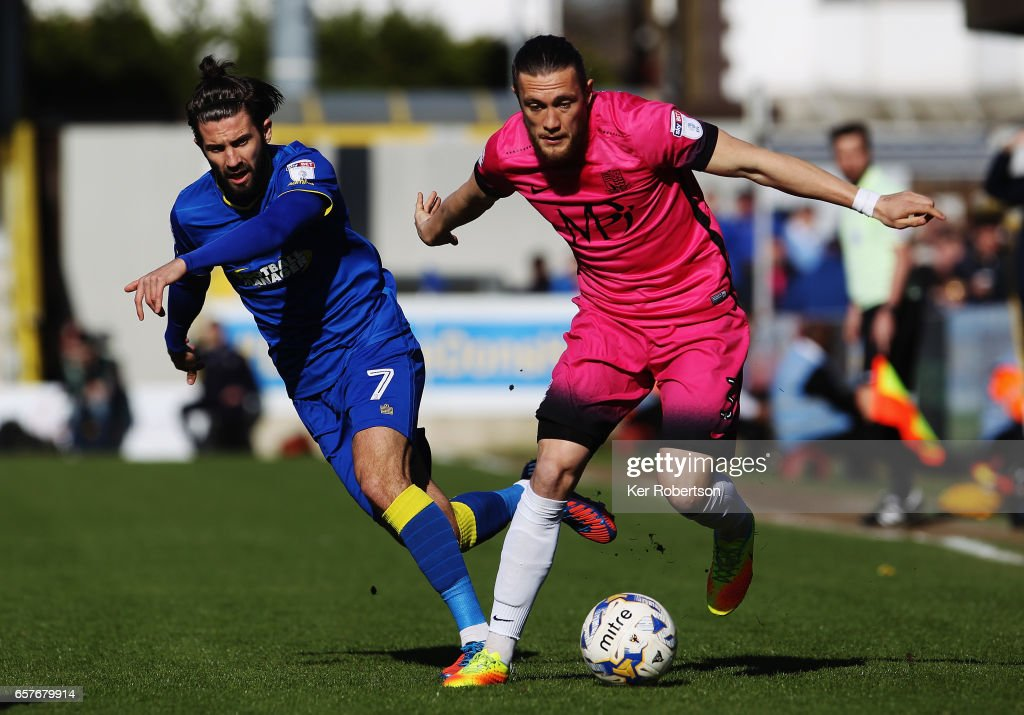 Ben Coker (R) of Southend United holds off the challenge of George Francomb of A.F.C. Wimbledon during the Sky Bet League One match between A.F.C. Wimbledon v Southend United at the Cherry Red Records Stadium on March 25, 2017 in Kingston upon Thames, United Kingdom.