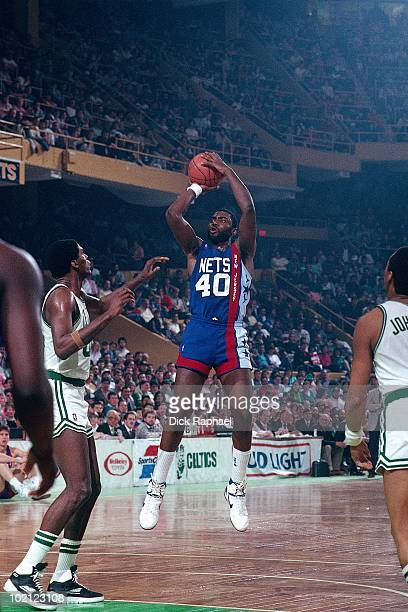 Ben Coleman of the New Jersey Nets shoots a jump shot against the Boston Celtics during a game played in 1987 at the Boston Garden in Boston...