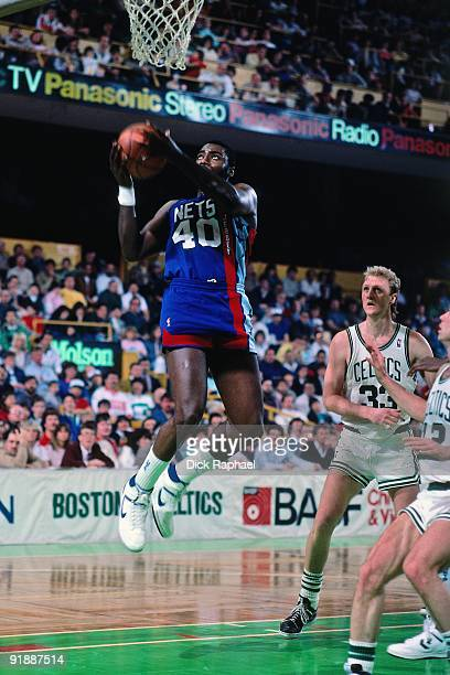 Ben Coleman of the New Jersey Nets takes the ball to the basket against the Boston Celtics during a game played in 1987 at the Boston Garden in...