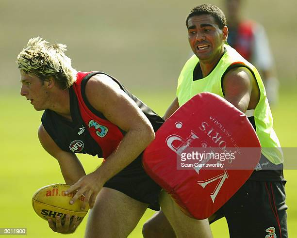 Ben Cosgriff and Justin Murphy of Essendon in action during an Essendon Bombers training session held at LaTrobe University February 25, 2004 in...