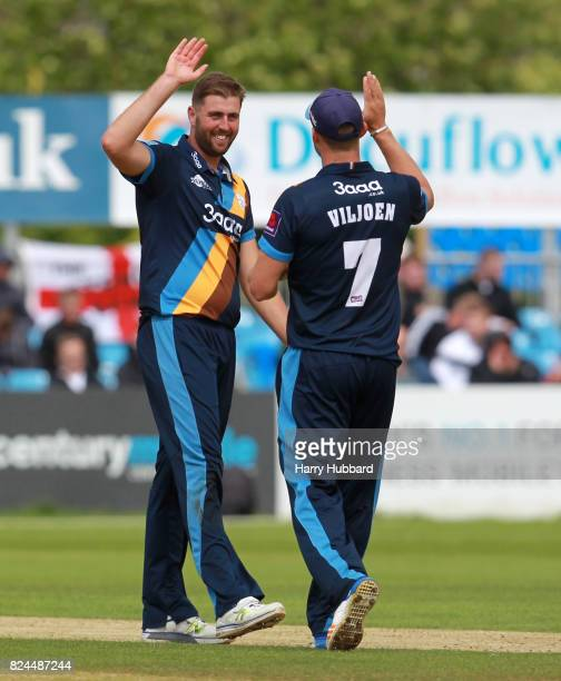 Ben Cotton of Derbyshire Falcons celebrates the wicket of Colin Ackermann of Leicestershire Foxes during the Natwest T20 Blast match between...
