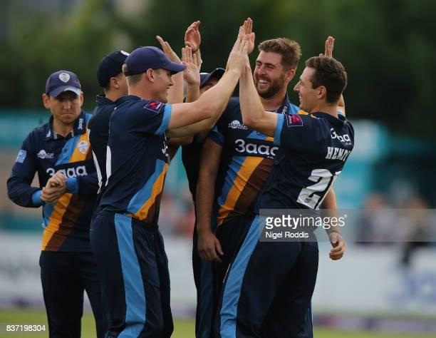 Ben Cotton of Derbyshire Falcons celebrates with teamates after taking the wicket of Calvin Dickinson of Hampshire during the NatWest T20 Blast at...