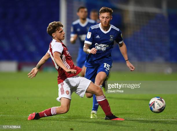 Ben Cottrell of Arsenal passes the ball under pressure from Teddy Bishop of Ipswich during the Leasingcom Cup match between Ipswich Town and Arsenal...