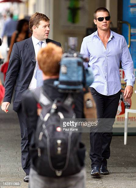 Ben Cousins and his lawyer Michael Tudori arrive at the Perth Magistrates Court on April 2 2012 in Perth Australia Former AFL player Cousins was...