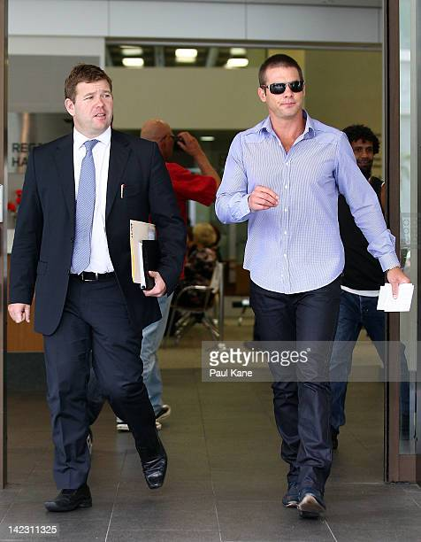Ben Cousins and his lawyer Michael Tudori depart from the Perth Magistrates Court on April 2 2012 in Perth Australia Former AFL player Cousins was...