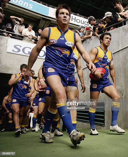 Ben Cousins for the Eagles leads his team out onto the ground during the AFL round 22 match between the West Coast Eagles and the Adelaide Crows at...