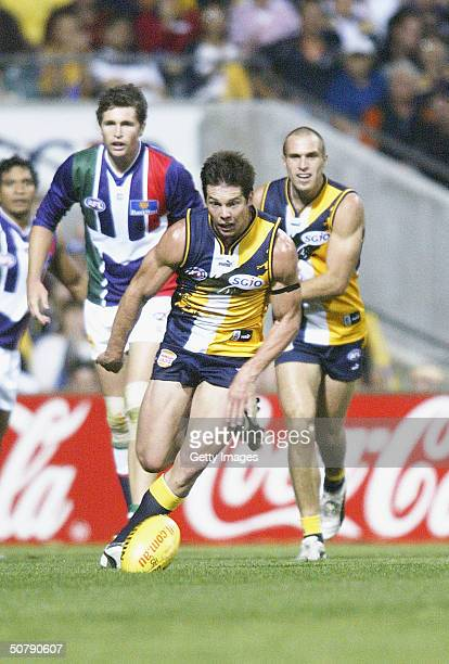 Ben Cousins of the Eagles in action during the round six AFL match between the West Coast Eagles and Fremantle Dockers at Subiaco Oval on May 1 2004...