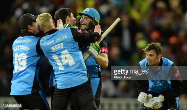 Ben Cox and Ed Barnard of Worcestershire celebrate with teammates after winning the Vitality T20 Blast Final between Sussex Sharks and Worcestershire...