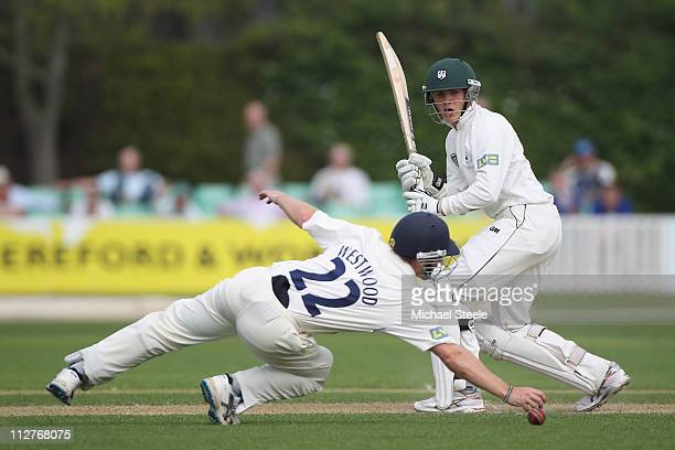Ben Cox of Worcestershire looks on as Ian Westwood of Warwickshire narrowly fails to take the catch during the LV County Championship match between...