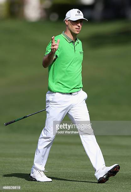 Ben Crane acknowledges the gallery on the 8th hole during the final round of the Humana Challenge in partnership with the Clinton Foundation on the...