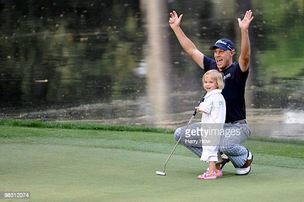 Ben Crane celebrates a putt holed by his daughter/caddie Cassidy during the Par 3 Contest prior to the 2010 Masters Tournament at Augusta National...