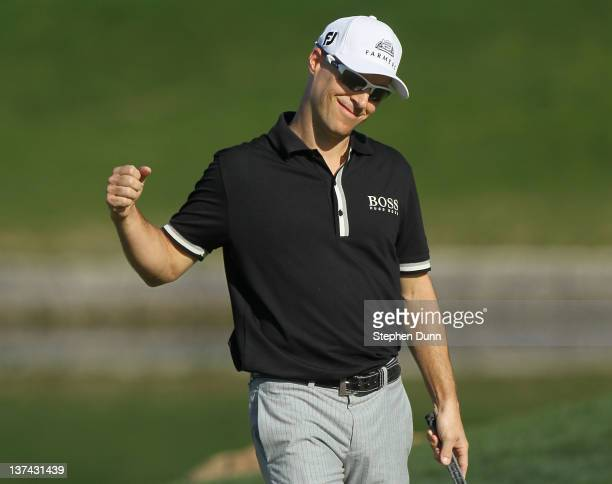 Ben Crane celebrates after making a birdie putt on the 9th hole his last of the round to go 16 under par for the tournament during the second round...