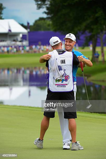 Ben Crane celebrates with caddie Joel Stock during the final round of the FedEx St Jude Classic at TPC Southwind on June 8 2014 in Memphis Tennessee