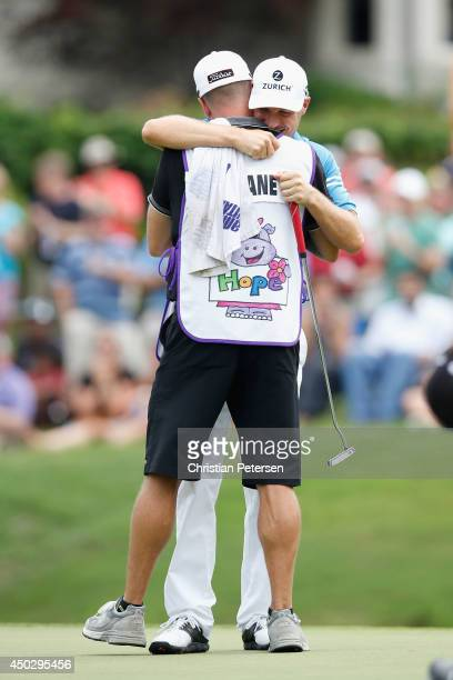 Ben Crane celebrates with his caddie Joel Stock after winning the FedEx St Jude Classic in the final round at the TPC Southwind on June 8 2014 in...