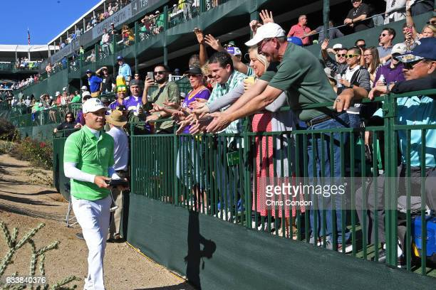Ben Crane hands out gifts to fans at the 16th hole during the third round of the Waste Management Phoenix Open at TPC Scottsdale on February 4 2017...