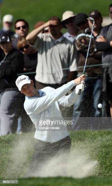 Ben Crane hits out of the bunker on the sixth hole during the final round of the 2010 Farmers Insurance Open on January 31 2010 at Torrey Pines Golf...