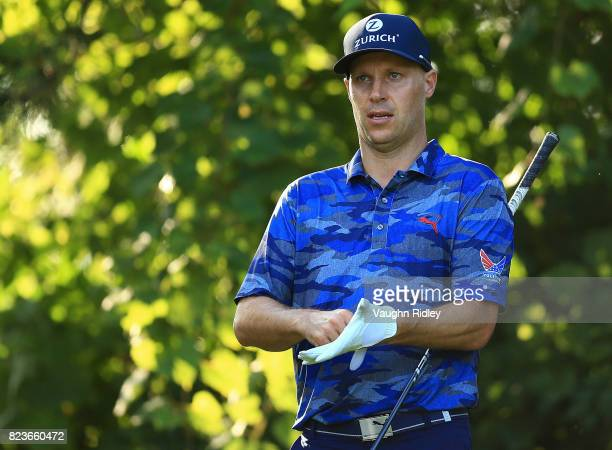 Ben Crane of the United States prepares to play his shot from the 16th tee during round one of the RBC Canadian Open at Glen Abbey Golf Club on July...