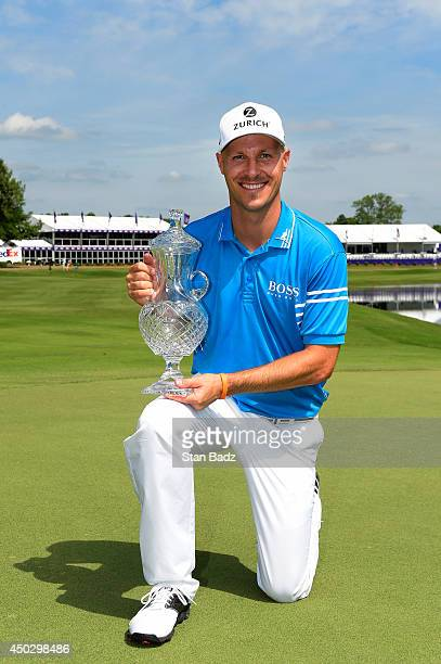 Ben Crane poses with the trophy after finishing as champion of the FedEx St Jude Classic at TPC Southwind on June 8 2014 in Memphis Tennessee