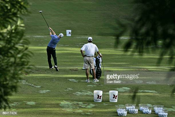 Ben Crane works on the practice range after his third round at the Mercedes Championships January 7 held at The Plantation Course at Kapalua Maui...