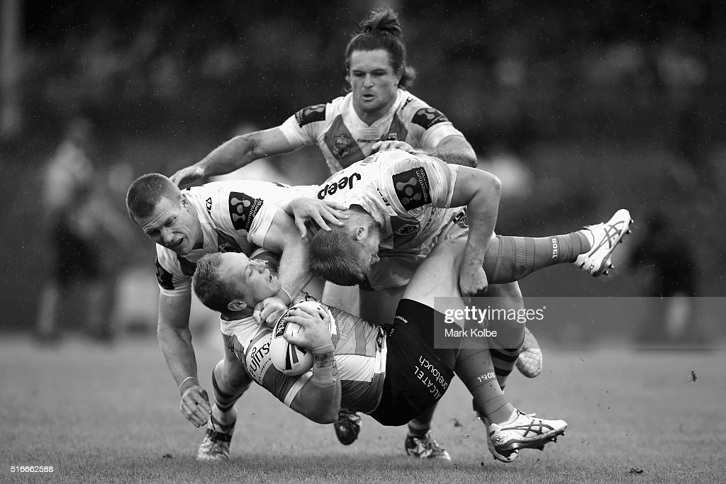 Ben Creagh, Mitch Rein and Will Matthews of the Dragons tackle Jason Clark of the Rabbitohs during the round three NRL match between the St George Dragons and the South Sydney Rabbitohs at Sydney Cricket Ground on March 20, 2016 in Sydney, Australia.