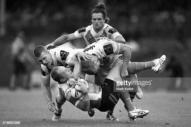 Ben Creagh Mitch Rein and Will Matthews of the Dragons tackle Jason Clark of the Rabbitohs during the round three NRL match between the St George...