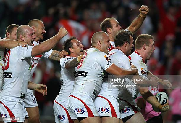 Ben Creagh of the Dragons celebrates scoring a try with team mates during the round eight NRL match between the St George Illawarra Dragons and the...