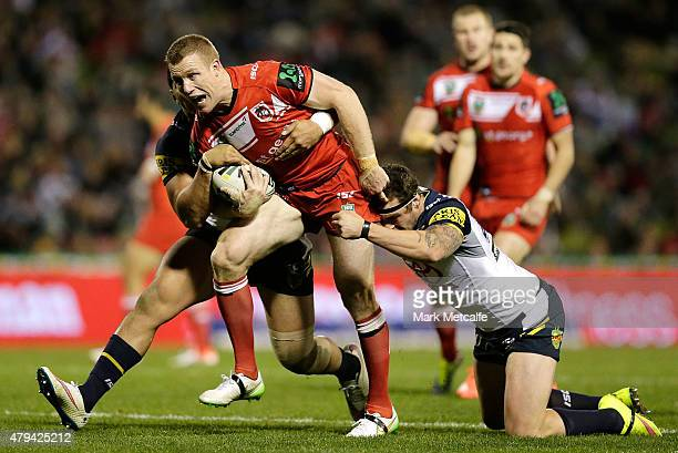 Ben Creagh of the Dragons is tackled during the round 17 NRL match between the St George Illawarra Dragons and the North Queensland Cowboys at WIN...