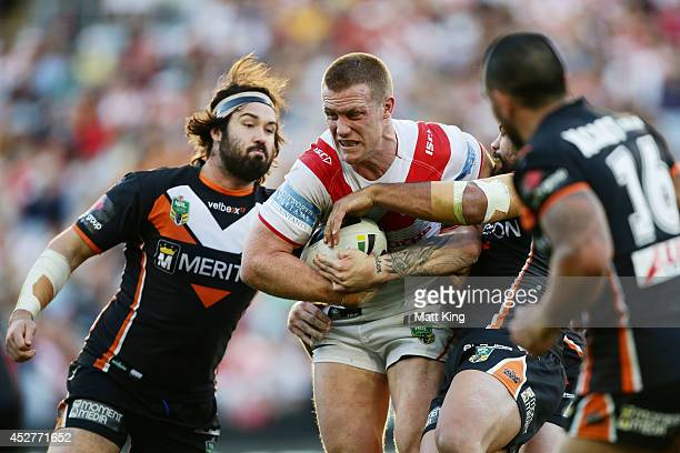 Ben Creagh of the Dragons is tackled during the round 20 NRL match between the Wests Tigers and the St George Illawarra Dragons at ANZ Stadium on...