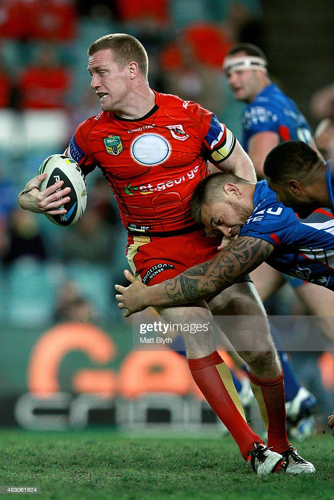 Ben Creagh of the Dragons is tackled during the round 21 NRL match between the Sydney Roosters and the St George Illawarra Dragons at Allianz Stadium on August 2, 2014 in Sydney, Australia.