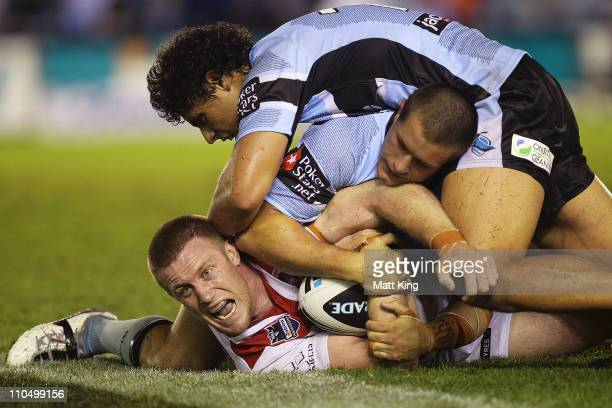 Ben Creagh of the Dragons is tackled during the round two NRL match between the Cronulla Sharks and the St George Illawarra Dragons at Toyota Stadium...