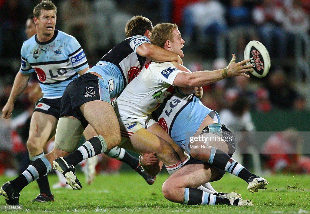 Ben Creagh of the Dragons offloads during the round 13 NRL match between the St George Illawarra Dragons and the Cronulla Sharks at OKI Jubilee Stadium June 11, 2007 in Sydney, Australia.