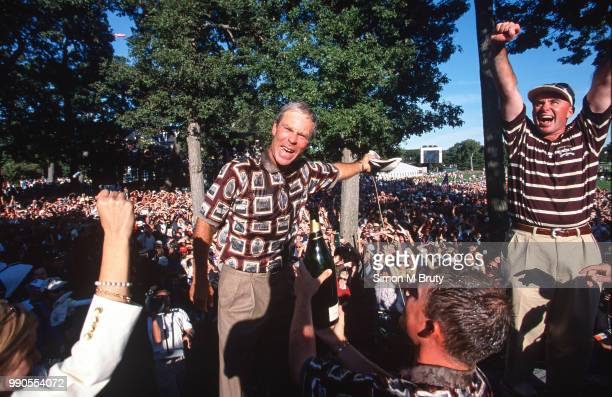 Ben Crenshaw captain of the USA team celebrates after his team wins the Ryder Cup at The Country Club on the September 26 1999 in Brookline...