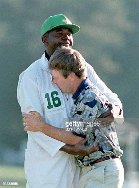 Ben Crenshaw hugs his caddie Carl Jackson on the eighteenth green after winning the 1995 Masters Tournament at the Augusta National Golf Club in...