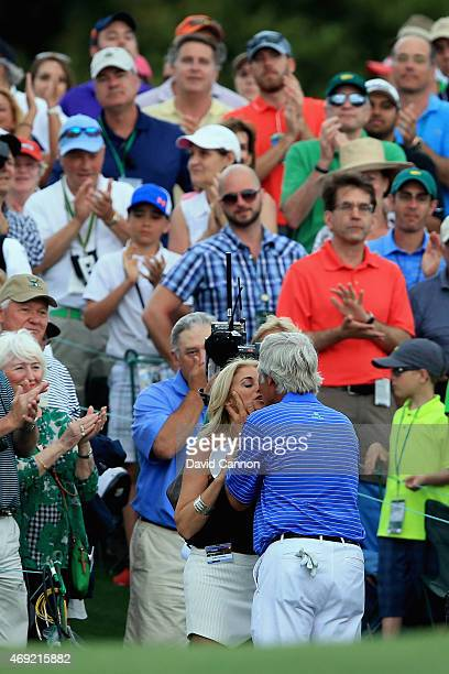 Ben Crenshaw of the United States kisses his wife Julie behind the 18th green after playing his final Masters during the second round of the 2015...