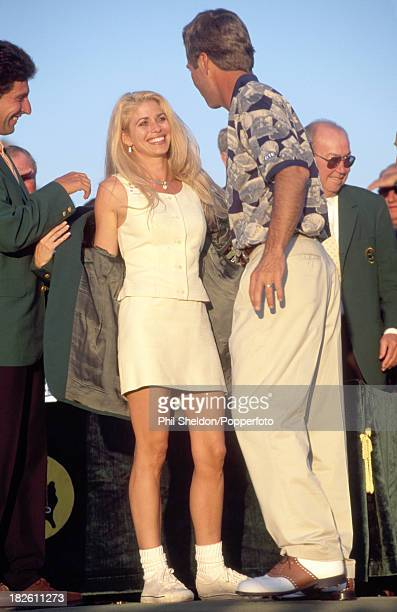 Ben Crenshaw of the United States with his wife Julie as she tries on her husband's Green Jacket after he won the US Masters Golf Tournament held at...