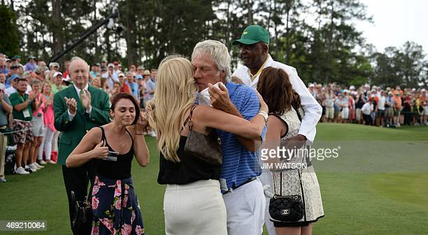 Ben Crenshaw of the US hugs his wife after finishing the 18th hole during Round 2 of the 79th Masters Golf Tournament at Augusta National Golf Club...