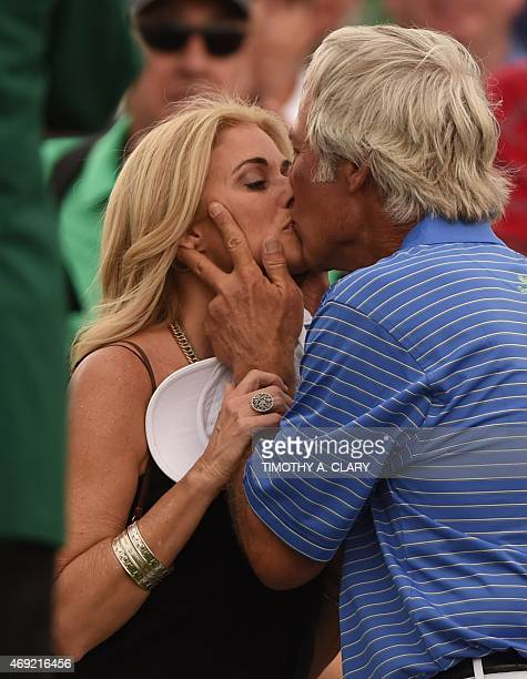 Ben Crenshaw of the US kisses his wife Julie after finishing Round 2 of the 79th Masters Golf Tournament at Augusta National Golf Club on April 10 in...