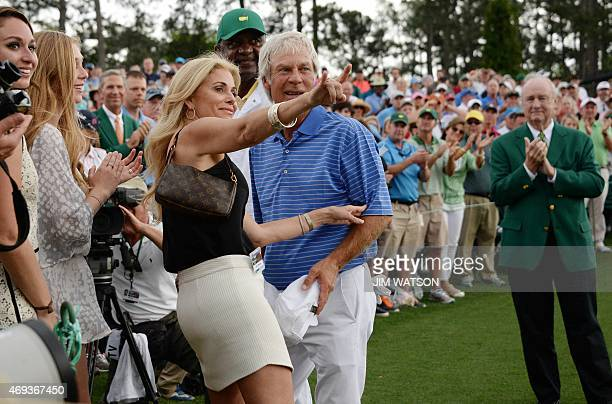 Ben Crenshaw of the US looks on as his wife Julie gestures to the crowd after he finished the 18th hole during Round 2 of the 79th Masters Golf...